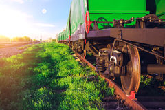 Railway station at sunset. Travel by train. Rail transportation. Railway station at sunset. Green grass and blue sky. Traffic lights shows green, red signal on stock image