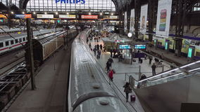 Railway station terminal in big city. Berlin, Germany - October, 9, 2016: Railway station terminal in Berlin Germany with passengers on platform waiting for stock footage