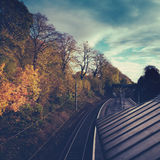 Railway Station And Tracks In Autumn. Historic Railway Station and Platform With Autumn Leaves Royalty Free Stock Photography
