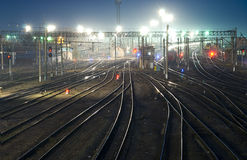 Railway station tracks perspective. Night shot of railway station tracks curving and going to the horizon Stock Image