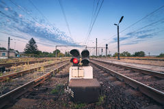 Railway station and traffic light at colorful sunset. Railroad Royalty Free Stock Photo