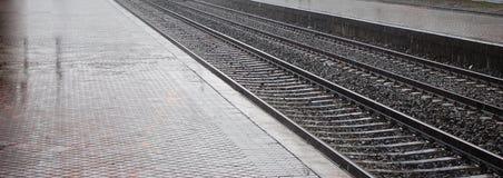 Railway of station of train. At rain Stock Photos