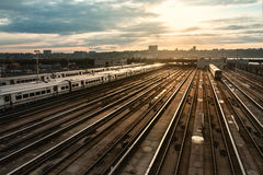 Railway station with train under sunset Royalty Free Stock Images
