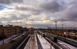 Railway station with trains on a background of storm clouds.  to Royalty Free Stock Photo