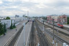 Railway station with trains, platform, wagons and peoples Stock Photography
