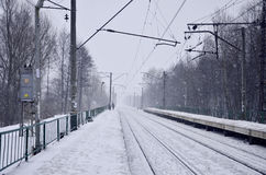 Railway station in the winter snowstorm Stock Photo