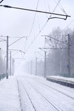 Railway station in the winter snowstorm Stock Image