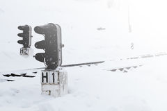 Railway station in winter, a traffic light in the village, Ukraine, Europe Royalty Free Stock Images