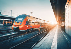 Free Railway Station With Beautiful Modern Red Commuter Train At Suns Stock Image - 80573901