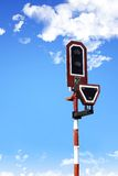 Railway stop light. On blue sky background Royalty Free Stock Photography