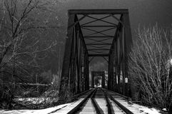 Railway after the storm. This image was taken right after a snow storm on a railroad bridge in Old Town, Maine Royalty Free Stock Photo