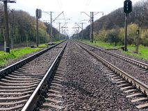 Railway stretches into the distance on a sunny day Royalty Free Stock Images