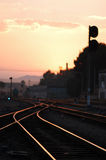 Railway in Sunset. Beautuful scene of railroad in dusk, with the burning clouds Stock Photo