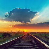 Railway in sunset with low clouds Royalty Free Stock Images