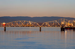 Railway swing bridge over Columbia River at sunrise Stock Images
