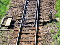 Railway switch detail. The single railway track splitting into two seen from above Stock Photo