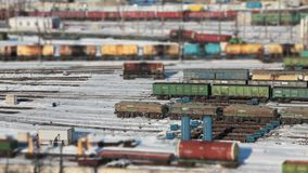 Railway tank cars with oil as if a toy railway. Railway station aerial view time lapse stock video