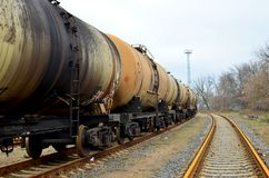 Railway tanks, transportation of oil, gasoline, oil or gas by rail. Logistics of transportation of goods by train by rail stock photography