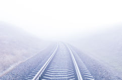 Railway to foggy horizon Stock Image