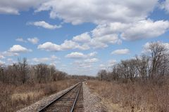 Railway to horizon and clouds on the sky Stock Image