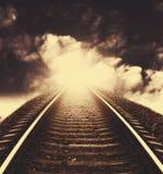 Railway to horizon under dramatic sky Stock Photography