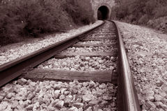 Railway track. Leading into the mouth of a tunnel Stock Photography