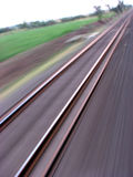 Railway Track. A unique view of a railway track taken from a train. The track still seems to be sharp while rest of the things are in motion Stock Photo