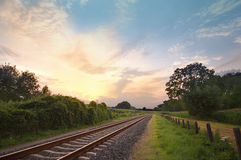 Railway track. Railway trach in a rural scene with a nice pastel sunset Royalty Free Stock Photo