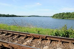 Railway track along the coast of the lake Stock Images