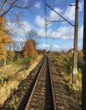 Railway track in autumn. Sunny railway track in autumn Stock Photo