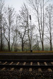 Railway track with bald trees in the fog in the winter. Europe city Stock Photo