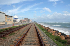 Railway track, the blue sky and the blue sea Royalty Free Stock Photos
