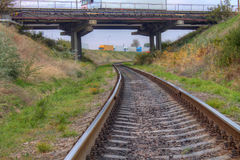 Railway track with  bridge above Stock Photo
