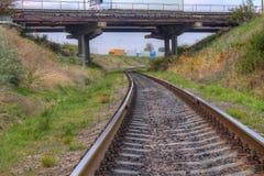Railway track with  bridge above Stock Photo