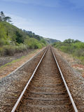 Railway track through countryside UK. Railway track through countryside Wales UK Royalty Free Stock Images