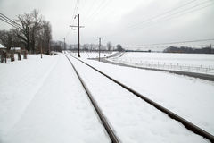 Railway track covered with snow Stock Photos
