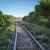 Railway track crossing rural landscape. Royalty Free Stock Image
