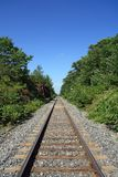 Railway track crossing wood Royalty Free Stock Photos