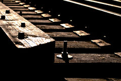 Railway track details. Close up of old railroad tracks and sleepers Stock Images