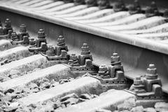 Railway track details, close up photo Stock Photos