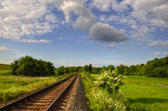 Railway. Track disappearing in a spring landscape Royalty Free Stock Images