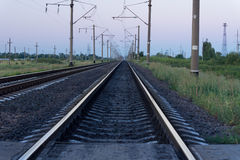 Railway track with electricity poles Royalty Free Stock Image