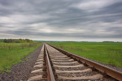 Railway track in the field Royalty Free Stock Photography