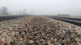 Railway track. In a foggy chilling winter morning Stock Image