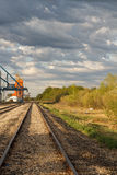 Railway track by grain elevator Royalty Free Stock Photo