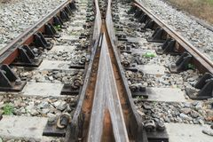 Railway track on gravel  for train transportation. Select focus with shallow depth of field Royalty Free Stock Photo