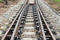 Railway track on gravel  for train transportation with copy space add text. Railway track on gravel  for train transportation: Select focus with shallow depth of Royalty Free Stock Photos
