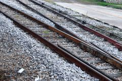 Railway track on gravel for train transportation Select focus with shallow depth of field. Railway track on gravel for train transportation: Select focus with Royalty Free Stock Images