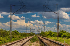 Railway track, HDR effect. Railway tracks with blue sky and clouds, HDR effect Royalty Free Stock Photo