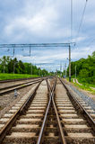 Railway track junction of two roads Stock Images